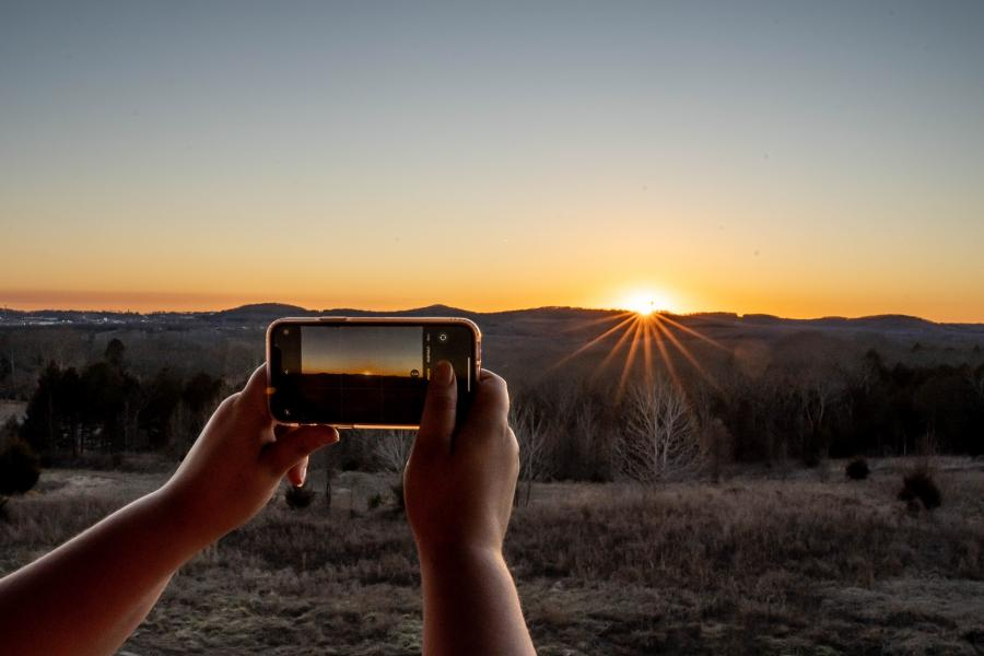 taking a picture of a sunset in Branson