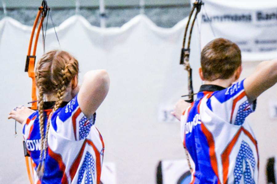 Two contenders shooting in a State Archery Tournament.