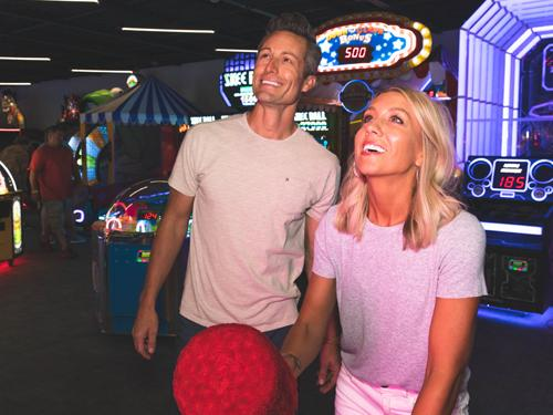 Man and woman on a date at an indoor arcade in Branson.