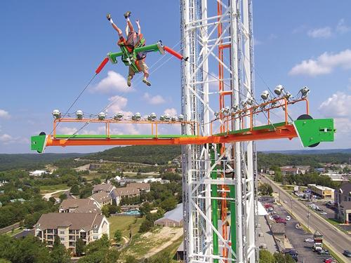 Thrill seekers riding a 200' tall slingshot attraction in Branson.