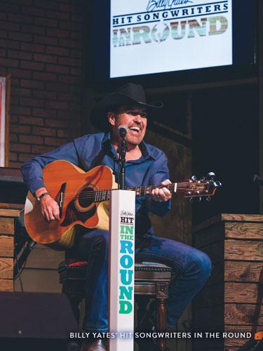 Man wearing black cowboy hat singing classic country songs on a live show stage in Branson.
