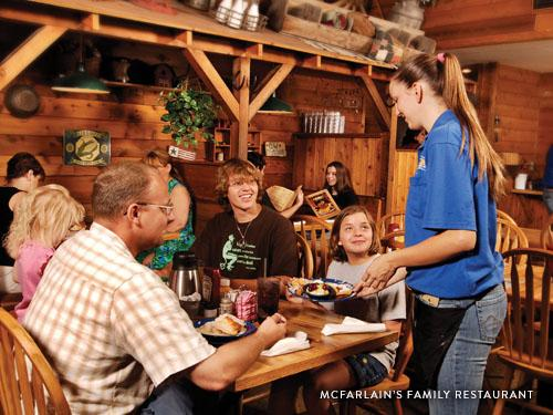 Family of four being served a home-style dinner at a country restaurant in Branson.