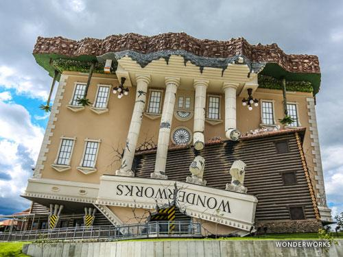 Attraction that looks like a huge upside-down yellow mansion or house in Branson.
