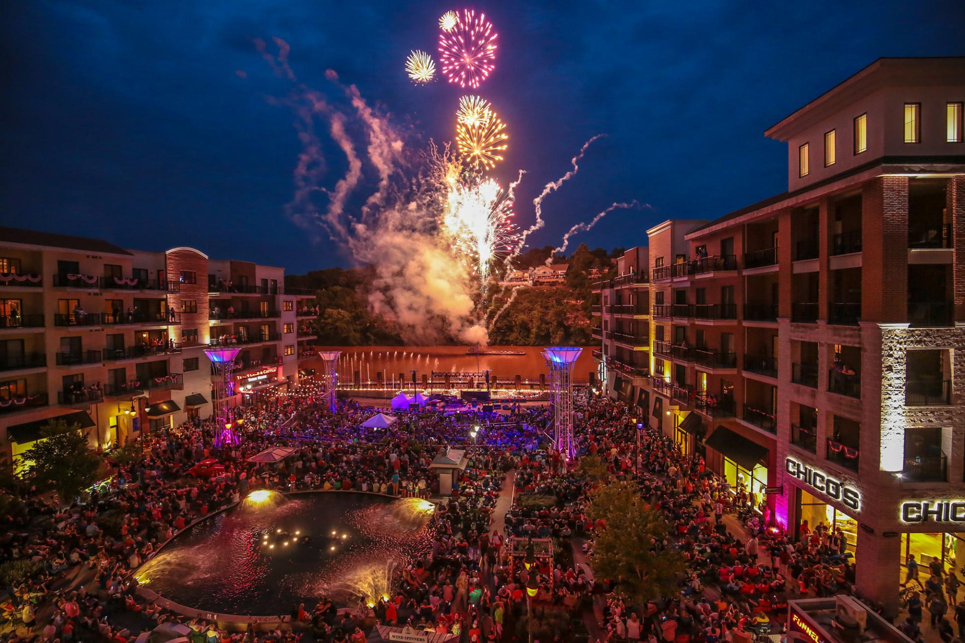 Fireworks at night with a large crowd at Branson Landing.