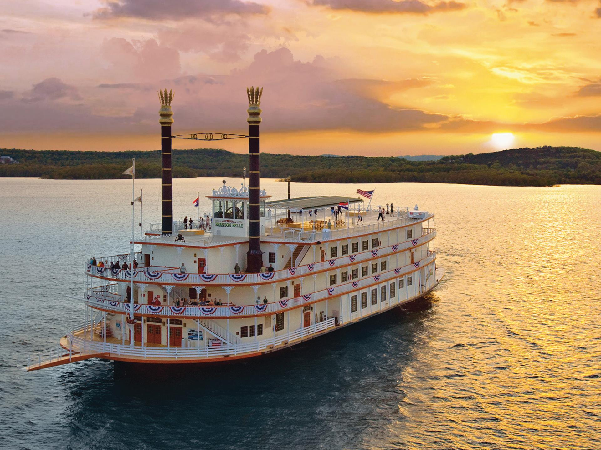 Sunset behind Showboat Branson Belle on the lake.