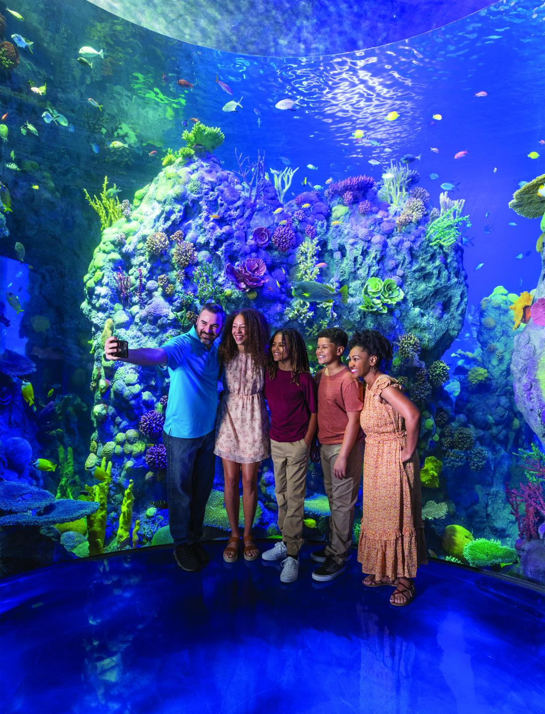 family taking photo at Branson Aquarium