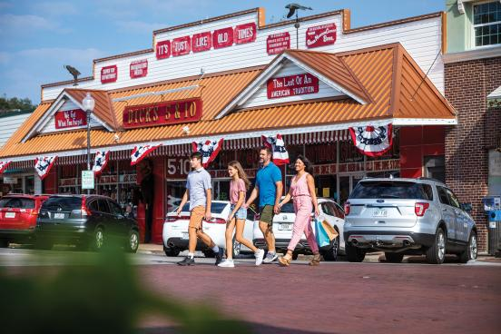 Family walking in front of general store in downtown Branson.