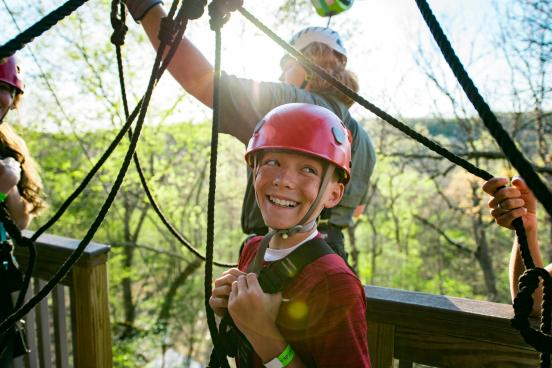 boy ziplining in branson