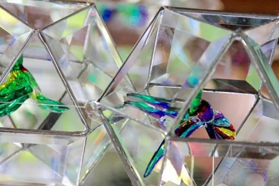 Glass prisms that hold small glass animal figurines at a craft mall in Branson.
