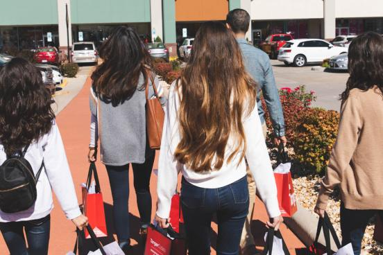Family of five shopping at an outlet mall.