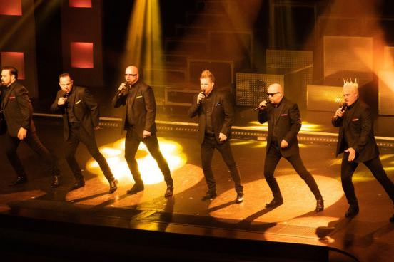 Six brothers performing a cappella on a live music show stage in Branson.