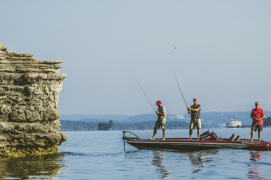 Group of three men bass fishing on Table Rock Lake in Branson.