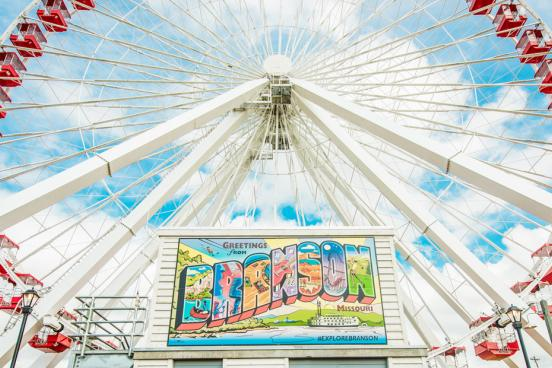 Mini Branson mural and Branson Ferris Wheel under a beautiful blue sky.