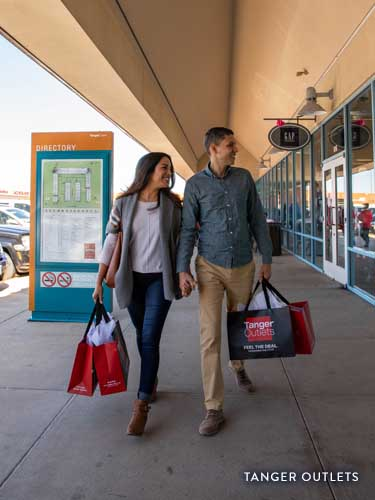 Couple shopping at Tanger Outlets