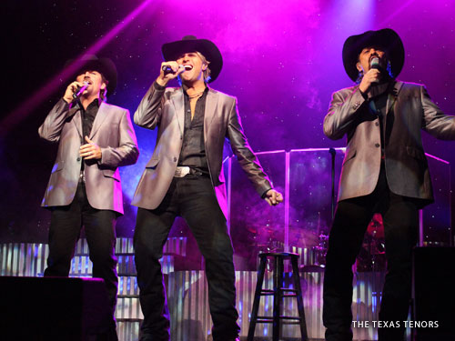 Three male live show performers singing classic country hits on a live show stage in Branson.