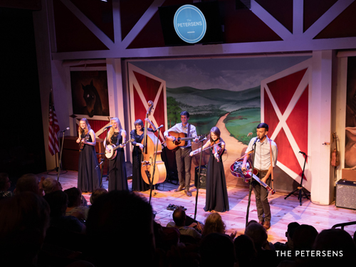 Family bluegrass band performing on Branson live show stage.