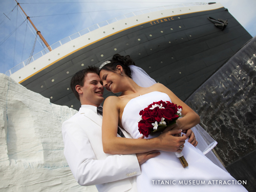 Bride and Groom standing in front of the Titanic Museum Attraction, the largest replica museum of the Titanic, in Branson.
