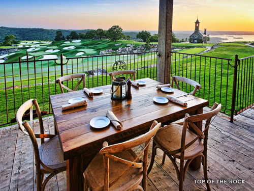 Table and chairs overlooking a famous golf course in Branson.