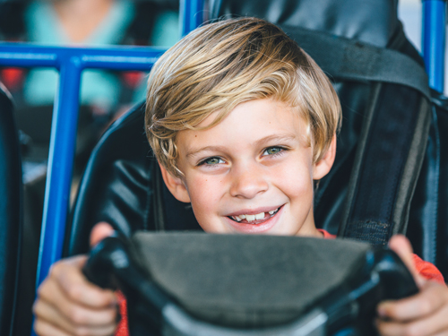 Young boy driving go-kart by himself in Branson.