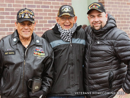 Three Veterans posing for picture at annual Veterans Homecoming Parade in Branson.