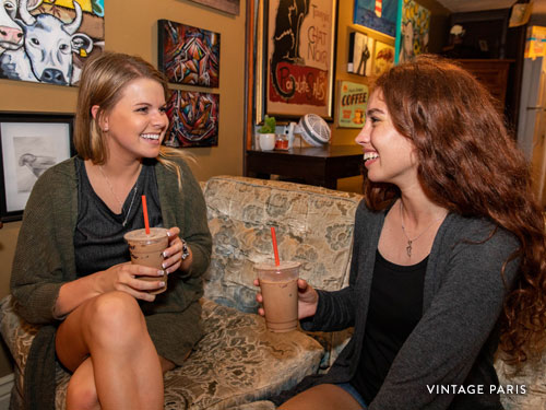 Two girl friends drinking coffee in a Branson coffee shop.